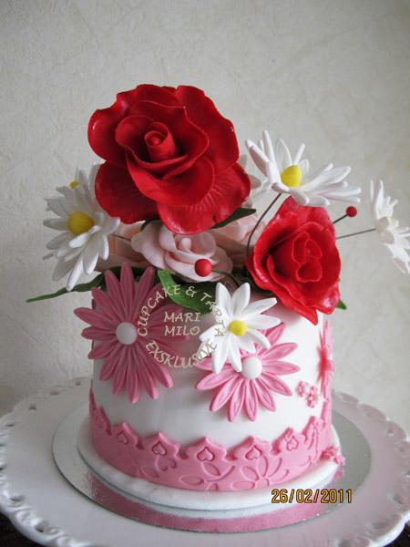 Prästkragar, rosor och tårta