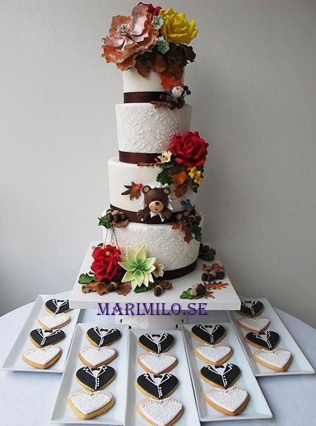Bröllopstårta och dekorerade bröllopskakor