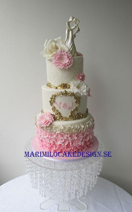 Bröllopstårta pastellfärg guld