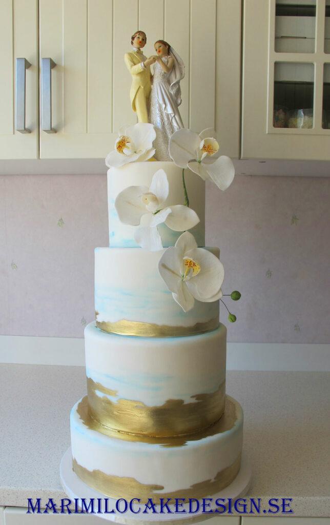 Bröllopstårta guld och blå
